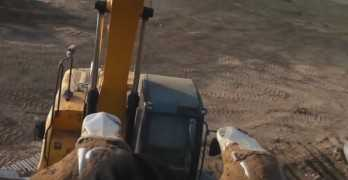Excavator Spinning With Some Friends